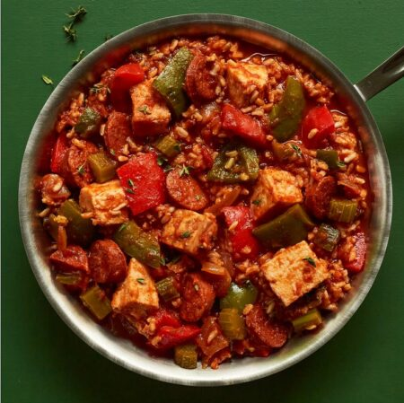 The Cajun Inspired Turkey Jambalaya is red in color with a green background